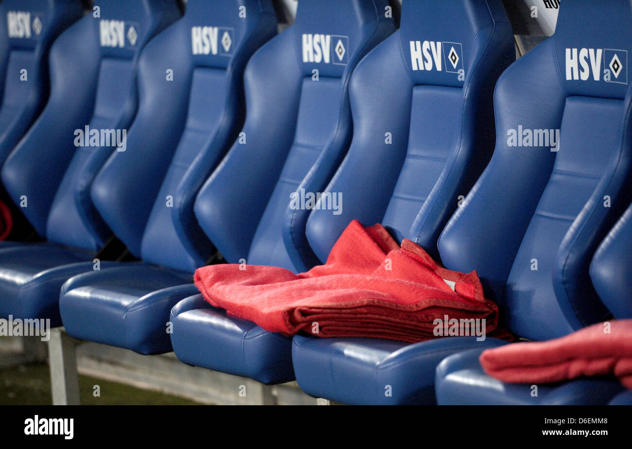 Red blankets are pictured lying on the substitutes' bench before the Bundesliga soccer match between Hamburger - Stock Image