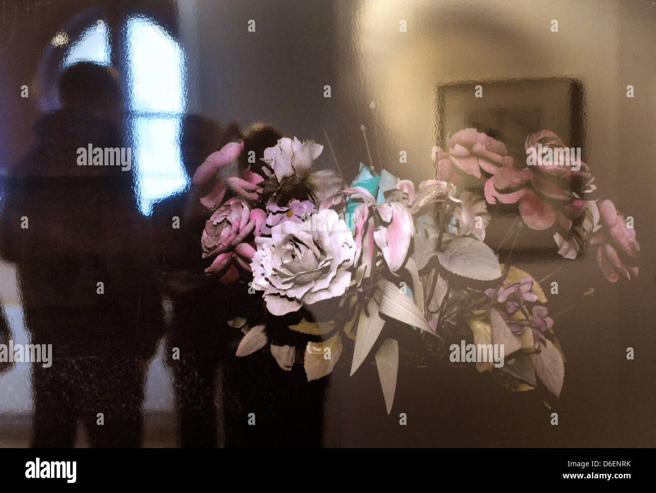 A young man looks at the pictrue 'Fleur du Mal' by Moritz Wehrmann at the Neues Museum in Weimar, Germany, - Stock Image