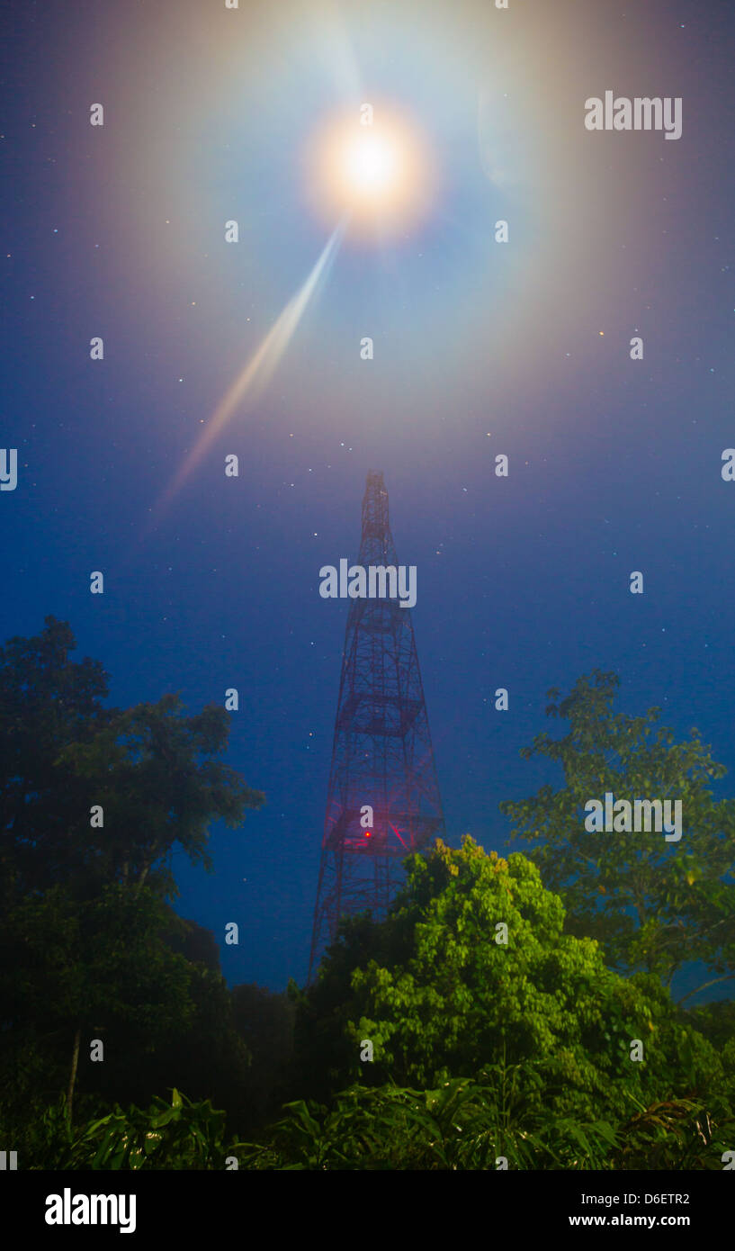 Moonlight and starry sky over the Global Atmosphere Watch Station tower in the Danum Valley in Sabah Borneo - Stock Image