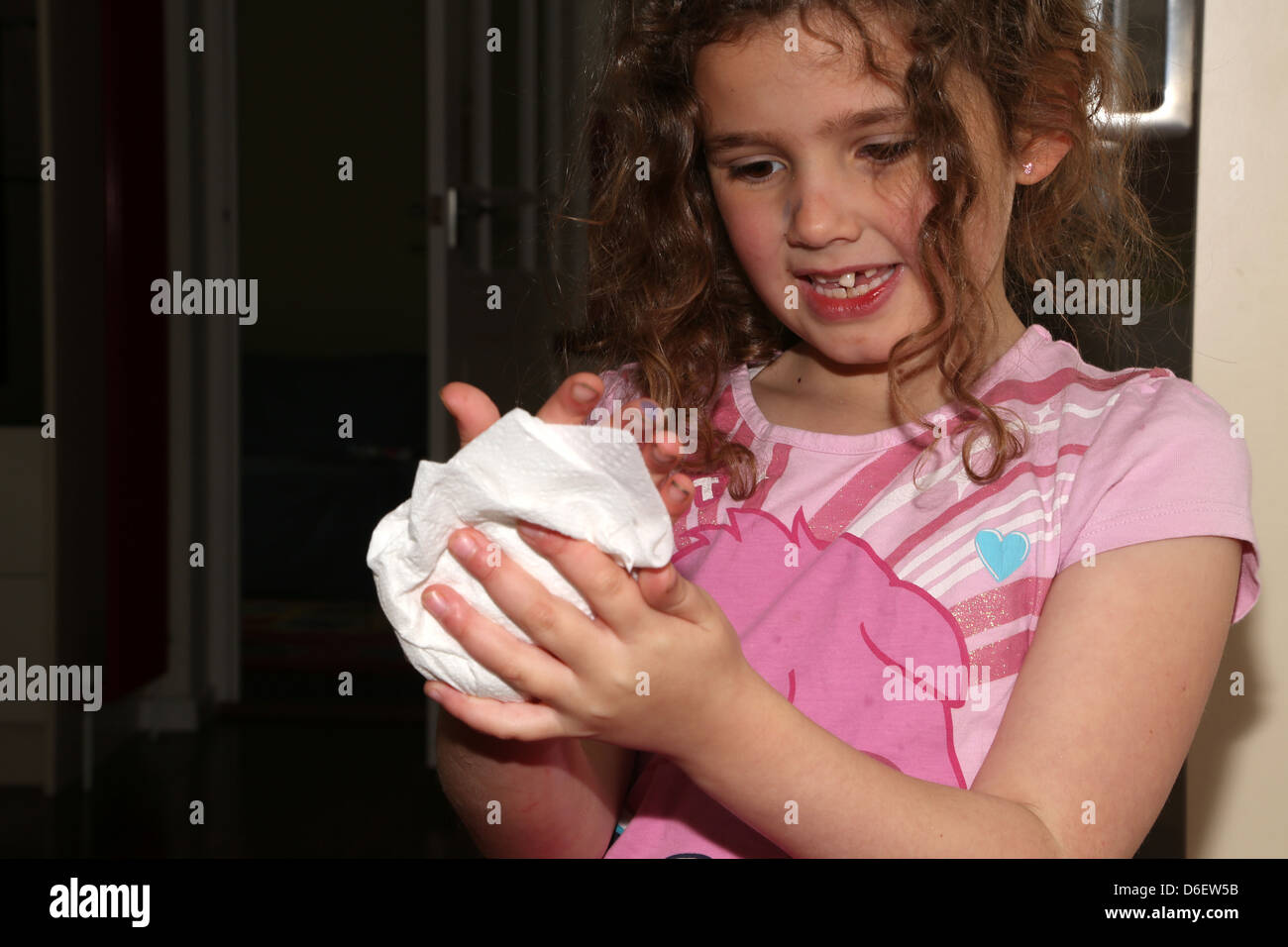 7 Year Old Girl Drying Hands On Paper Towel England Stock ...