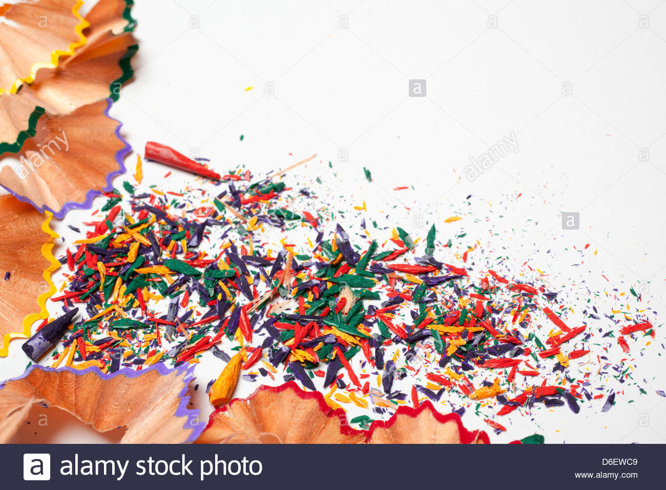 Close up colour pencil sharpenings - Stock Image