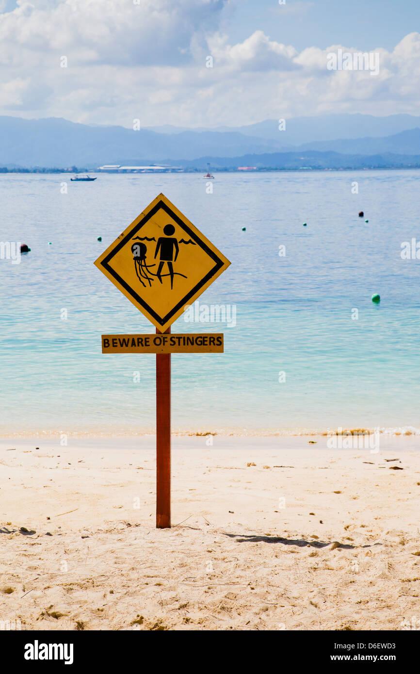 Beware of Stingers sign on the beach at Mamutik off Kota Kinbalu Sabah Borneo - Stock Image