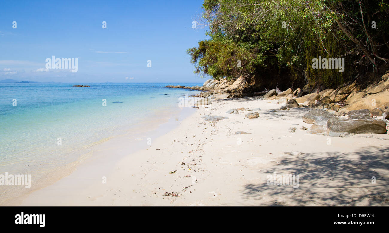 Deserted tropical beach and blue sea on the little island of Mamutik off Kota Kinabalu Malaysian Borneo - Stock Image