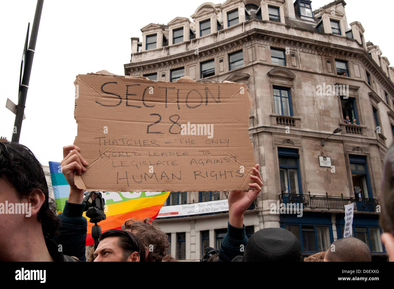 London, England UK 17/04/2013. A protester holds up a placard during a protest against honouring ex prime minister - Stock Image