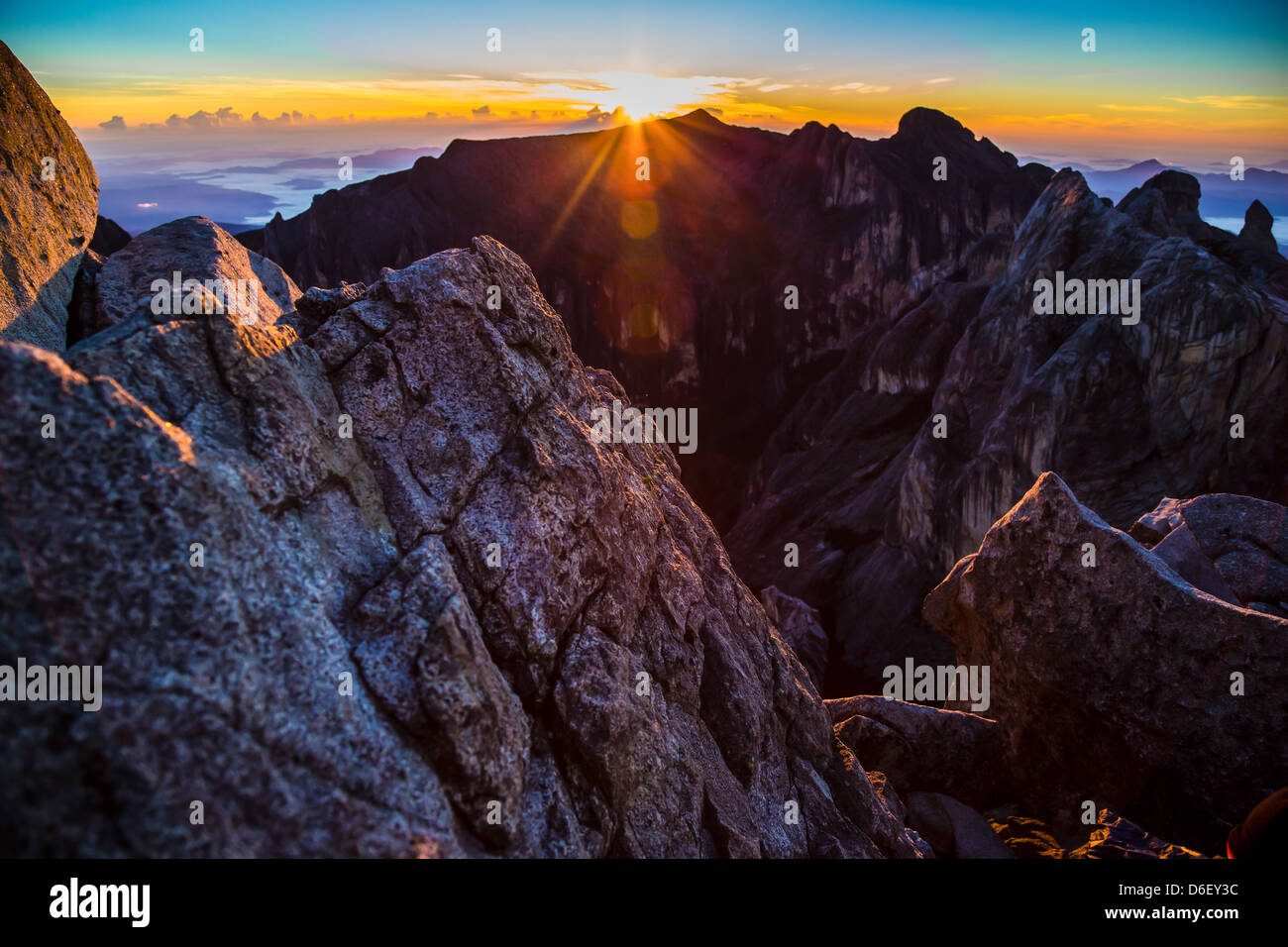 Sunrise over the dark defile of Low's Gully from the summit of Gunung Kinabalu 4095m Sabah Borneo - Stock Image