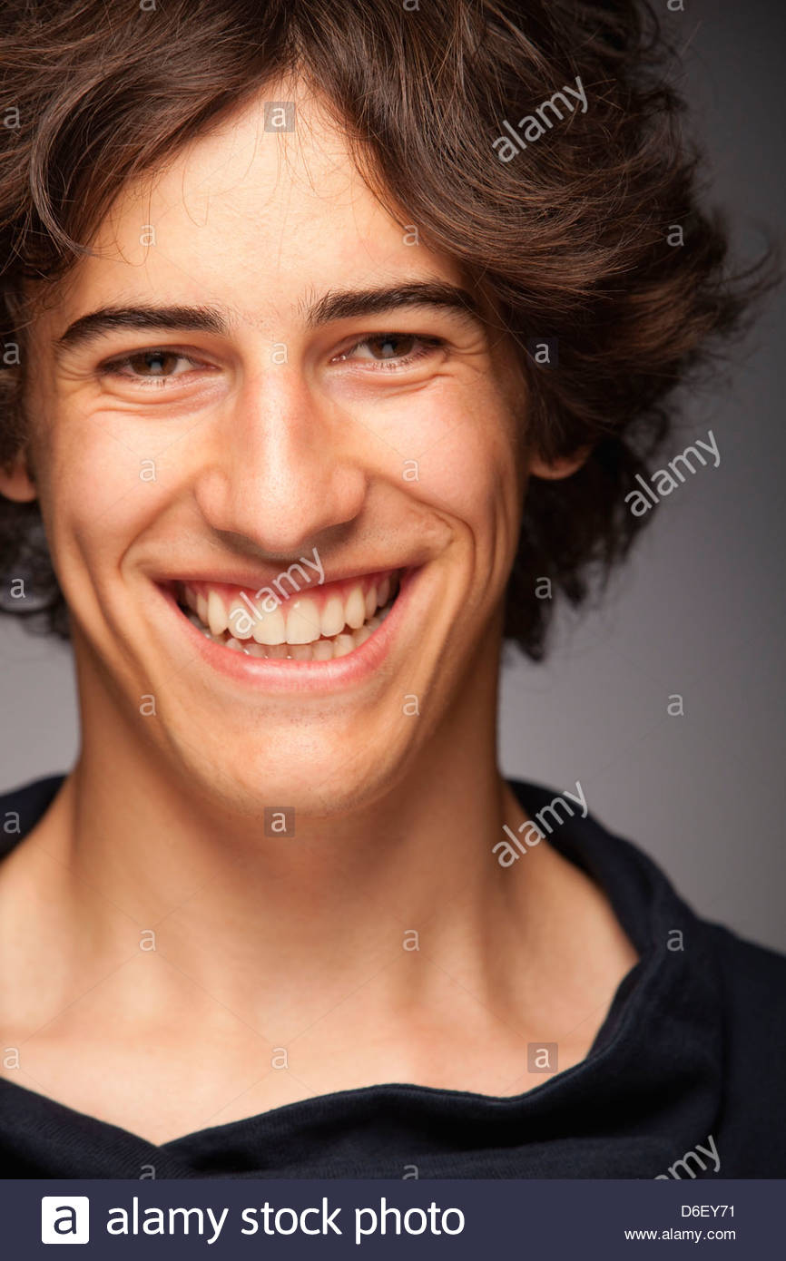 Teenager boy young man portrait smiling friendly - Stock Image