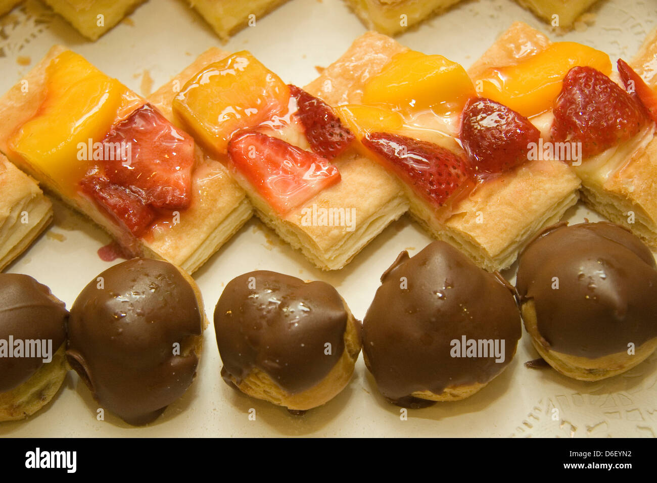 mini cakes on the midnight dessert buffet of a cruise ship - Stock Image