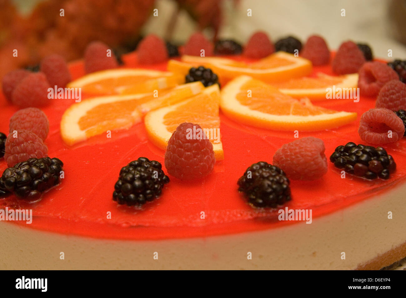 mixed berry cheesecake on the midnight dessert buffet of a cruise ship - Stock Image