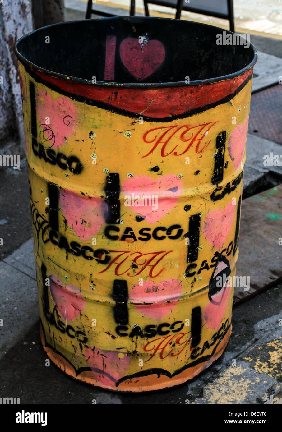 Colourful graffiti trash can - Stock Image