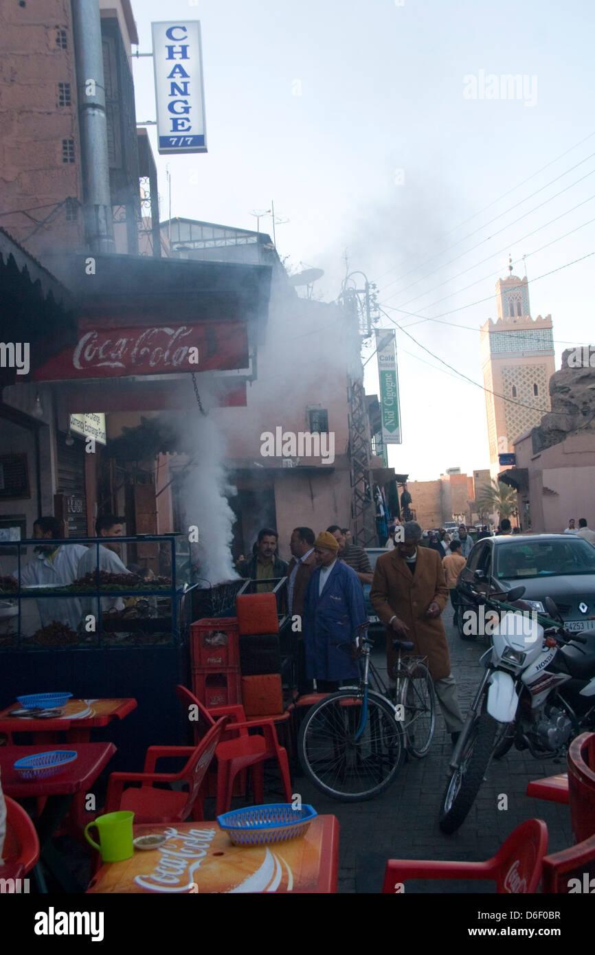 Food vendors and smoking BBQ's at the Place Djamaa al Fna in the Medina of Marrakesh - Stock Image