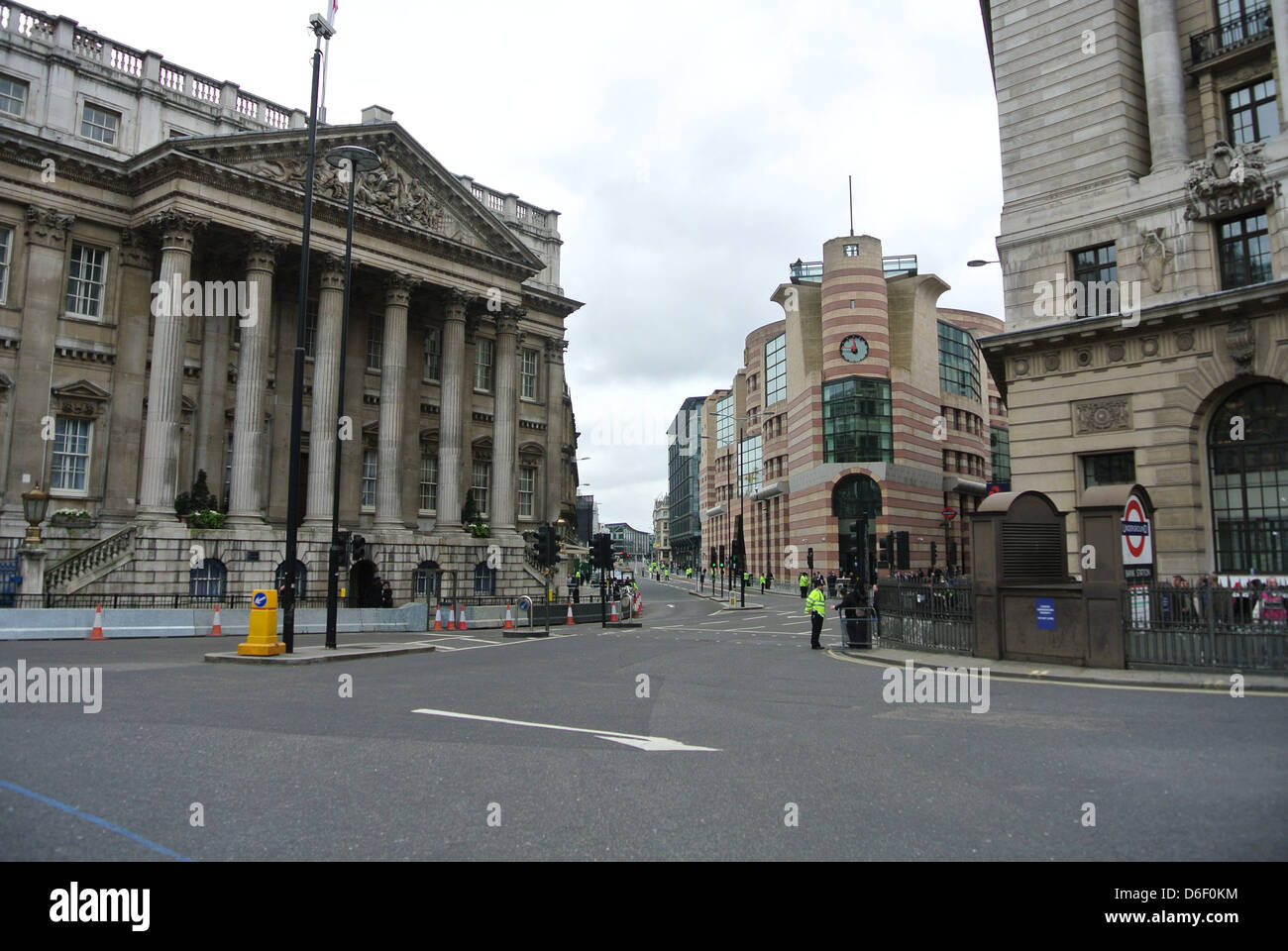 Bank station. Empty roads, no traffic, cars, buses. Day of Margaret Thatchers funeral. Line of police. London. UK - Stock Image
