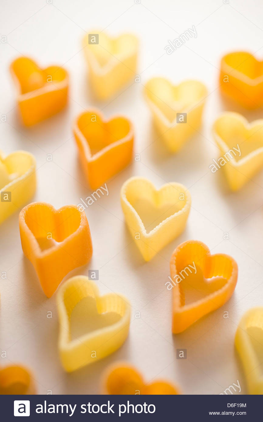Pasta heart shaped food romance noodles love - Stock Image
