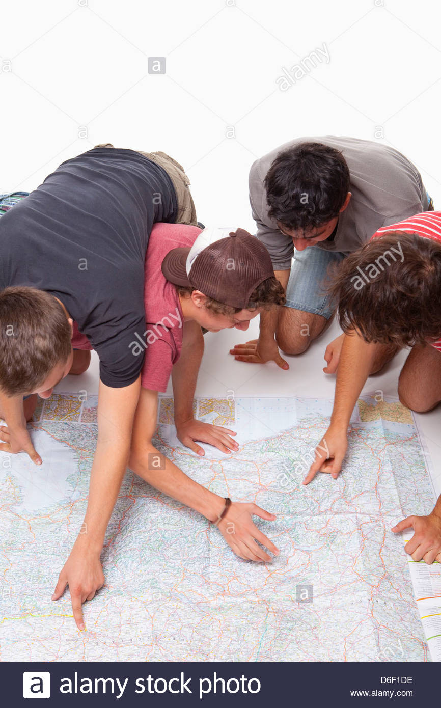 Teenagers map planning holiday vacation reading 4 - Stock Image