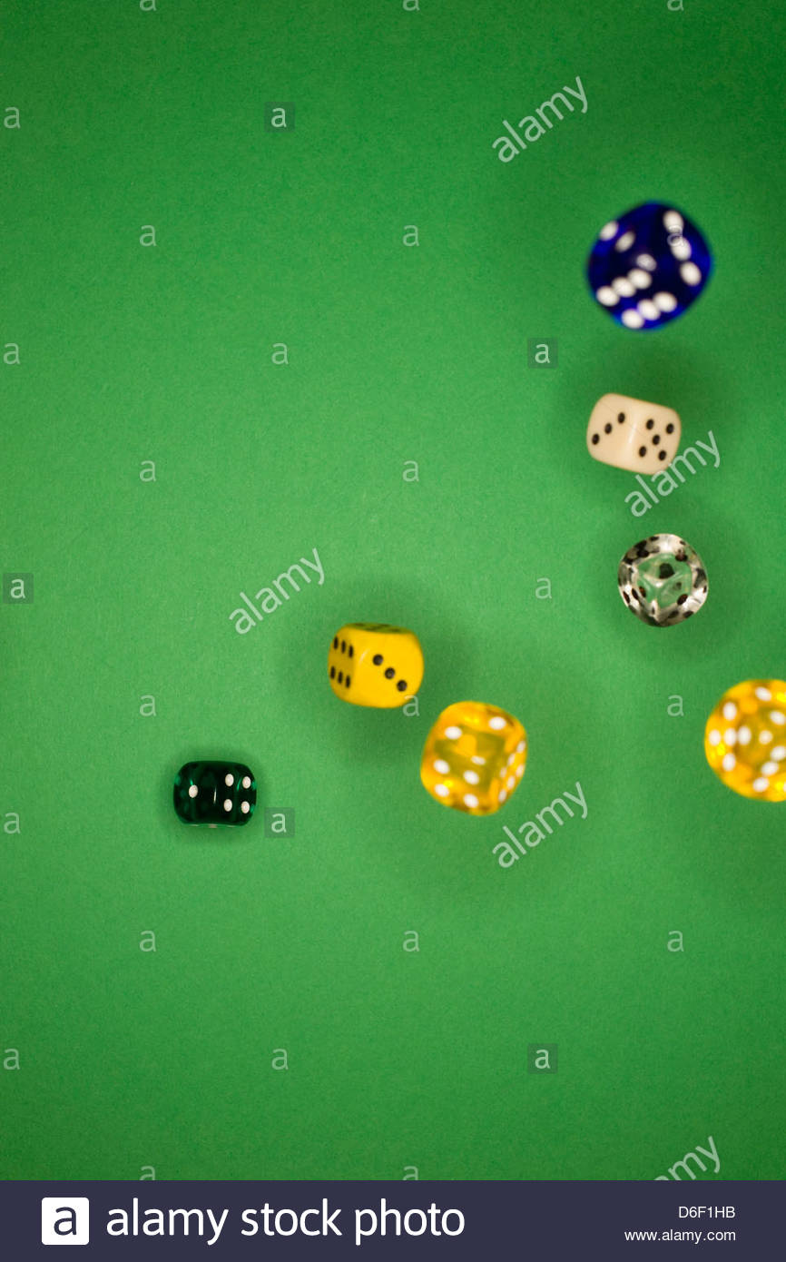 Dice multicolored throwing rolling gamble luck - Stock Image