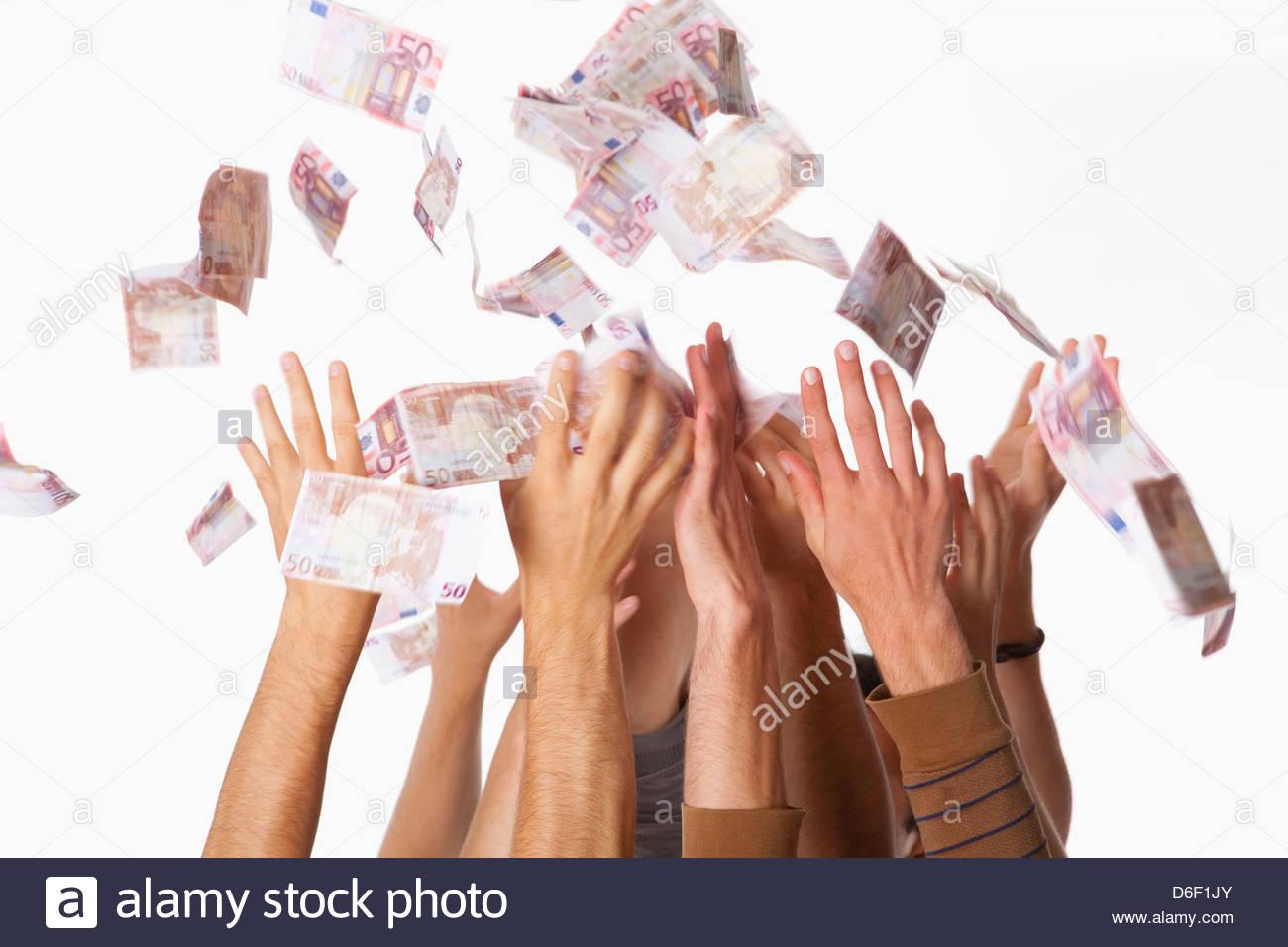 Money success teenagers falling raining rich boys - Stock Image