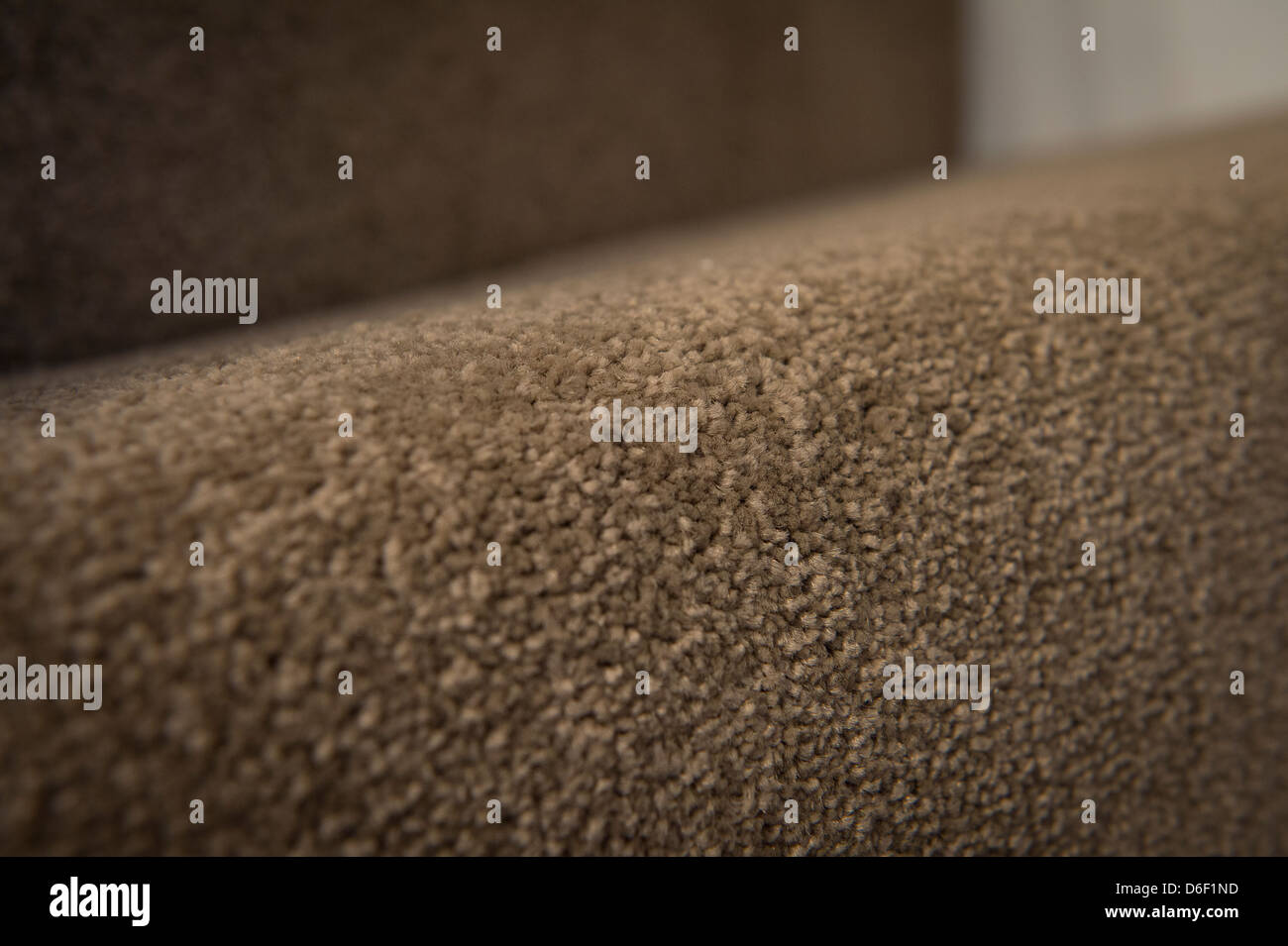 Close up of carpet on a flight of stairs. - Stock Image