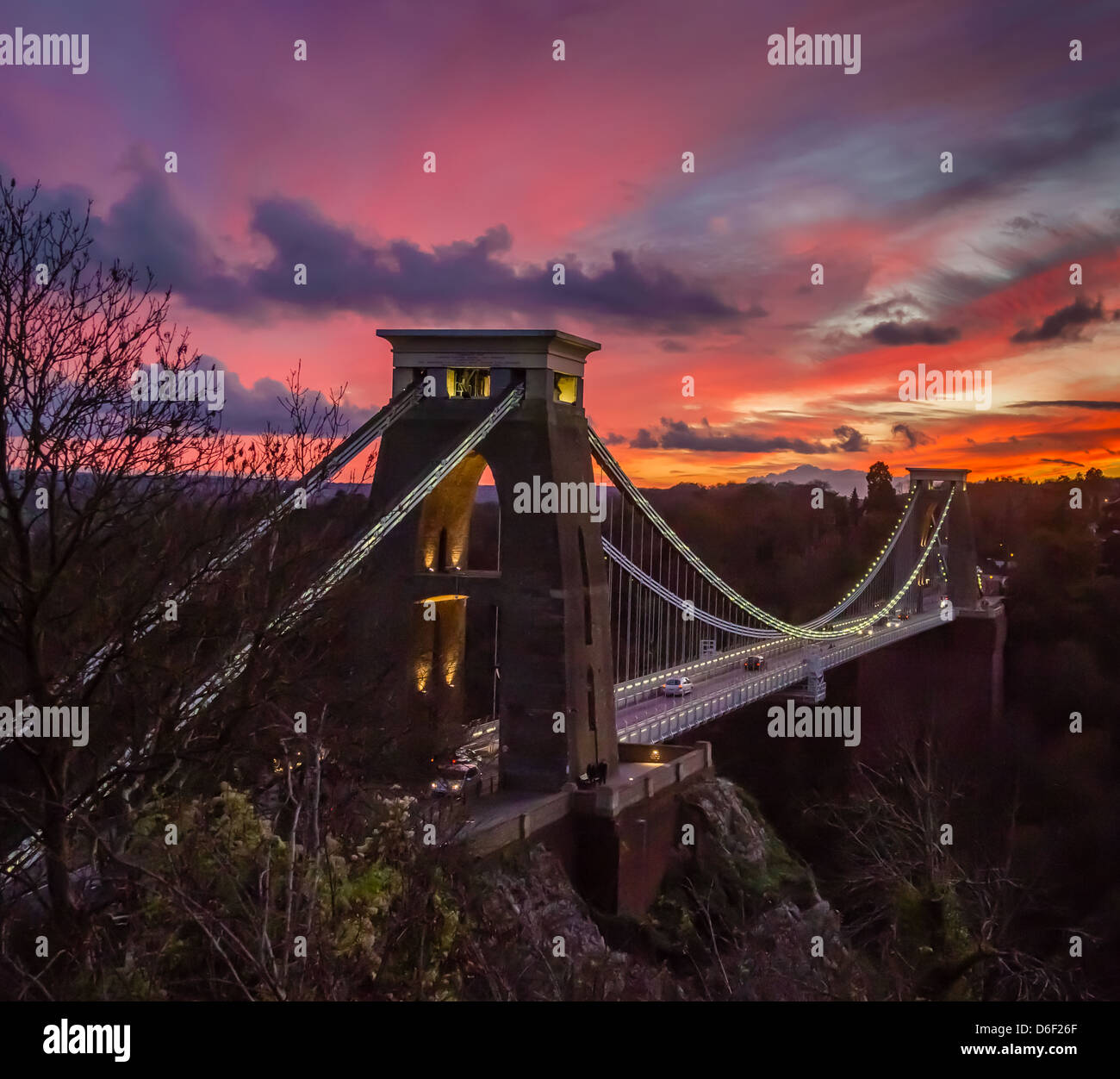 Clifton Suspension Bridge over the Avon Gorge Bristol illuminated at dusk with a colourful western sunset Stock Photo