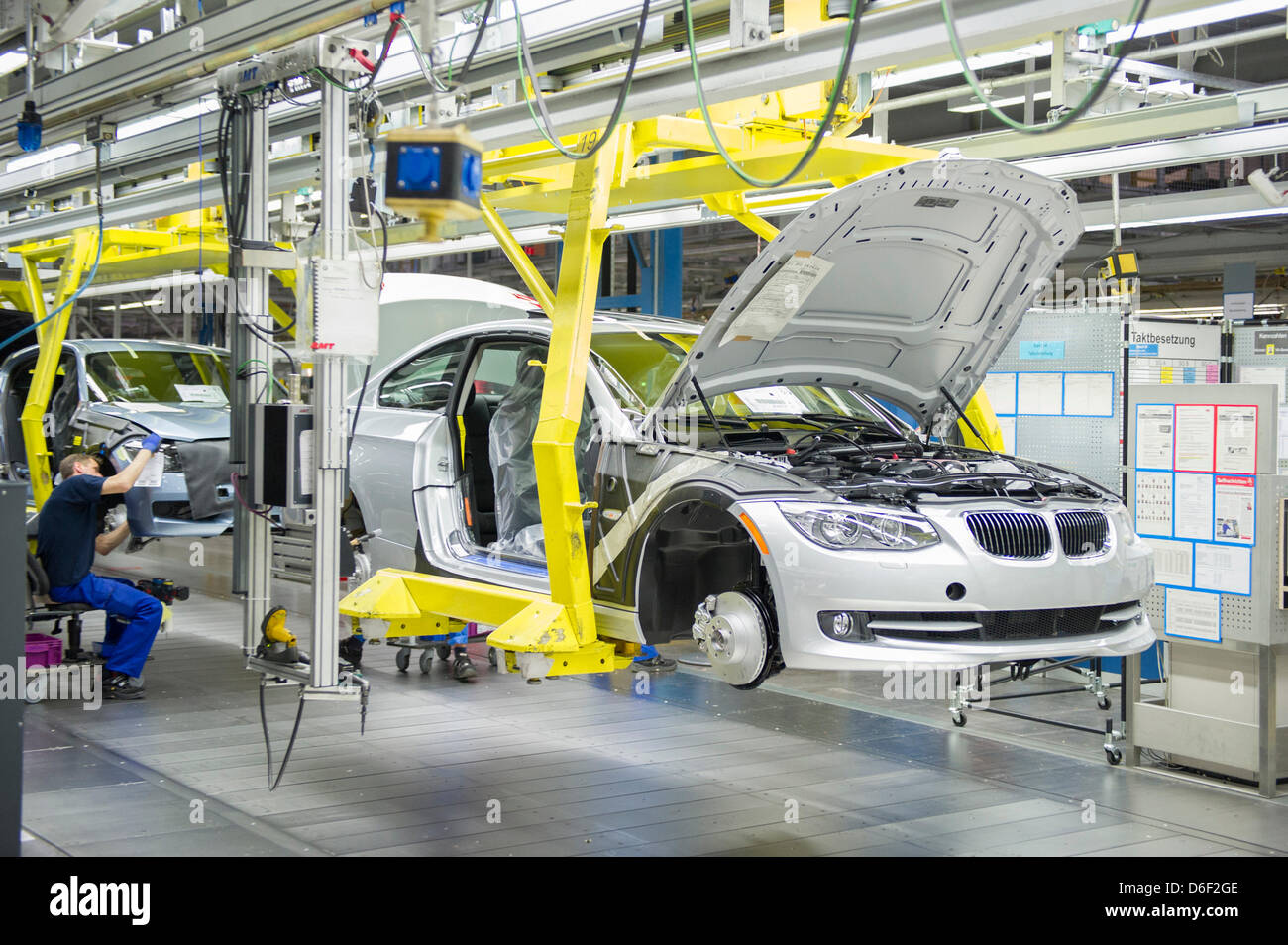 An Employee Of Car Manufacturer Bmw Works On A Car At The
