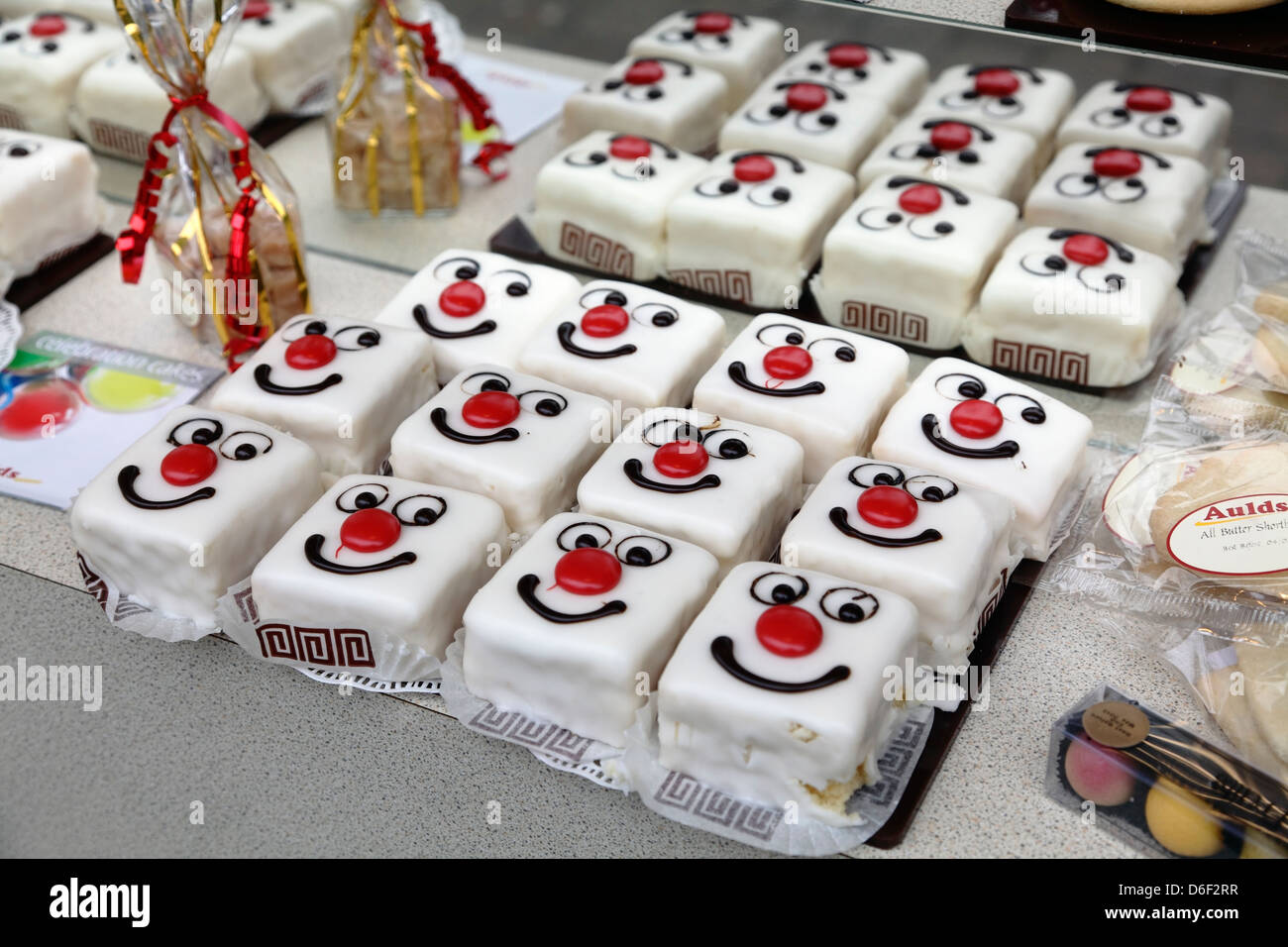 Red nose day cakes for sale in an Aulds Bakery Shop, Scotland, UK - Stock Image