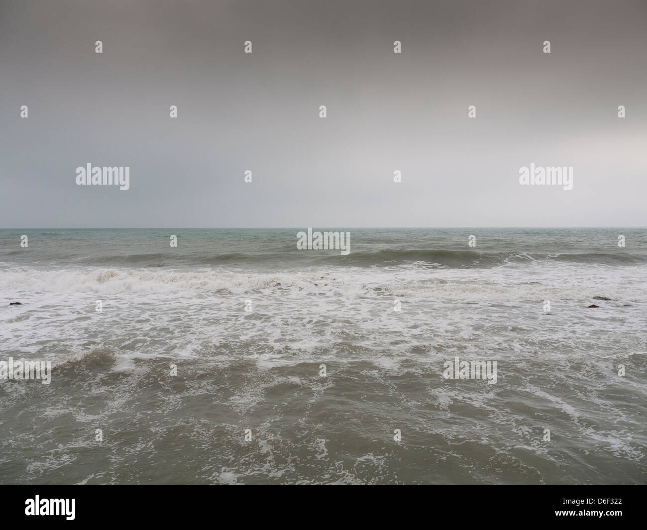 rough sea in winter with the cloudy sky, - Stock Image