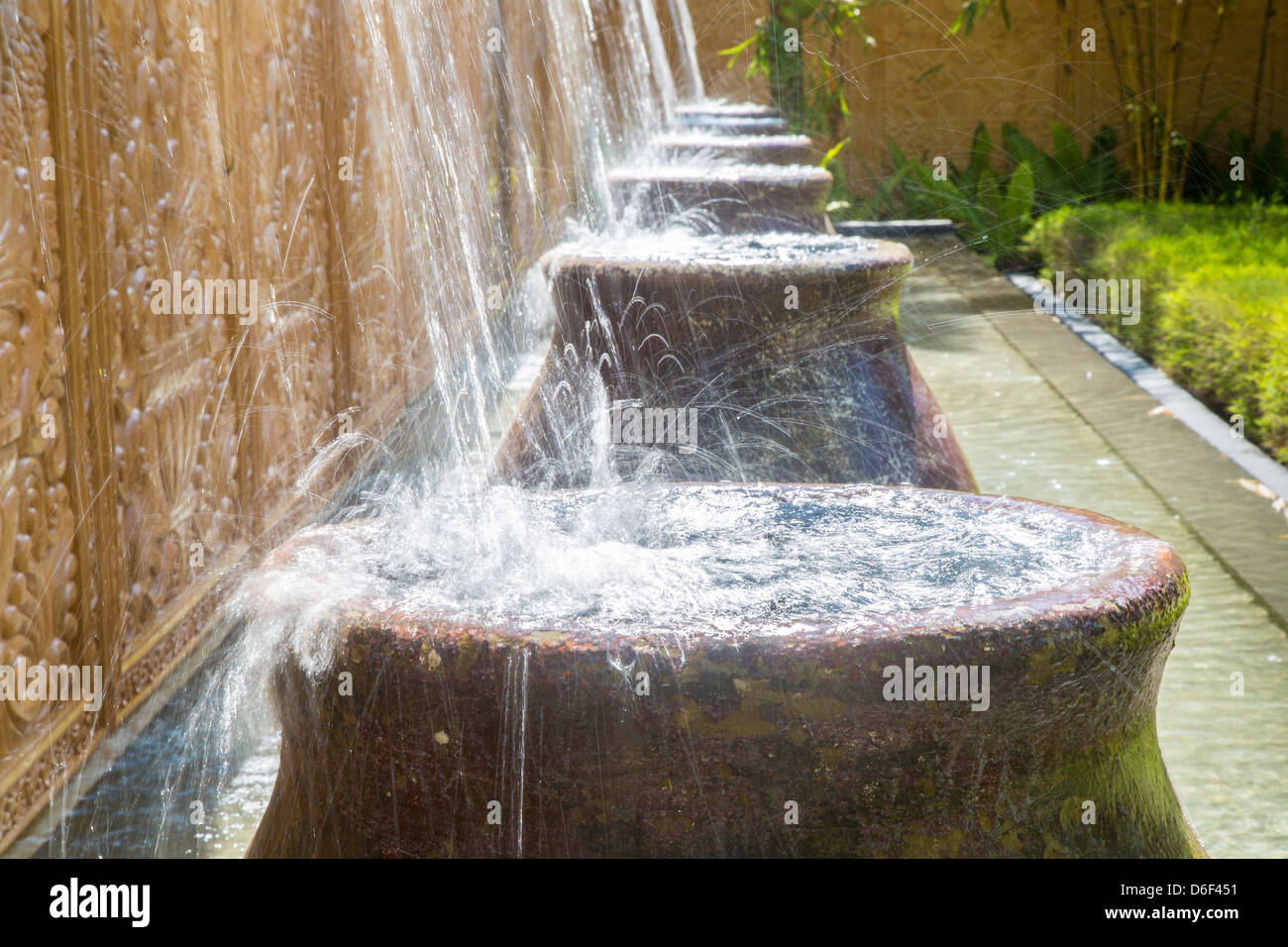 Water Splashing Into Big Pots By The Entrance To A Smart Hotel In Sabah  Borneo