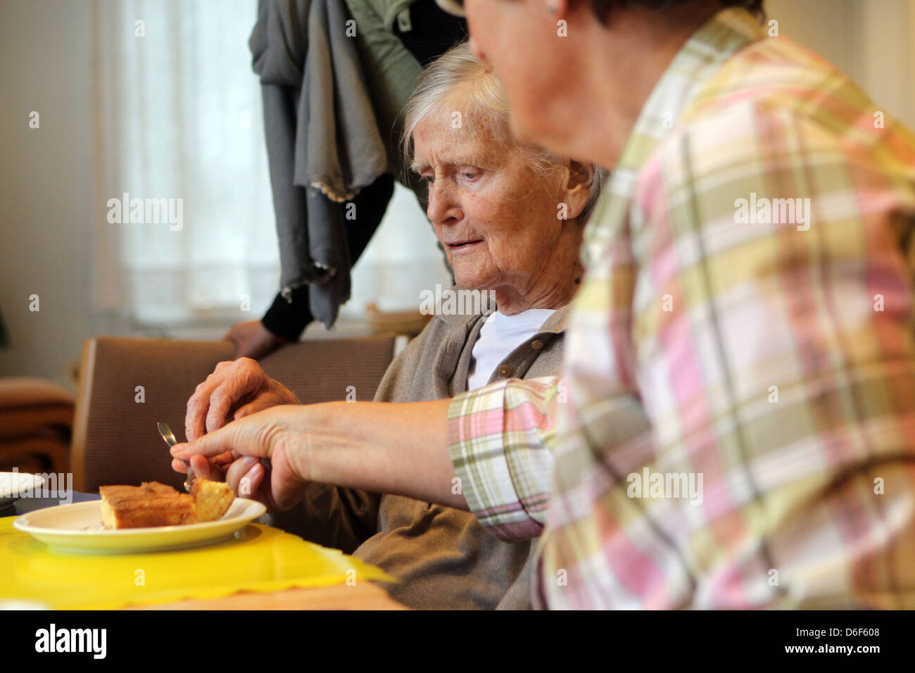 Flensburg, Germany, volunteers to take care in the family home for dementia patients - Stock Image