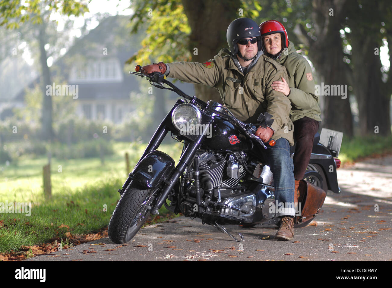 handewitt germany a couple sitting on his motorcycle a. Black Bedroom Furniture Sets. Home Design Ideas