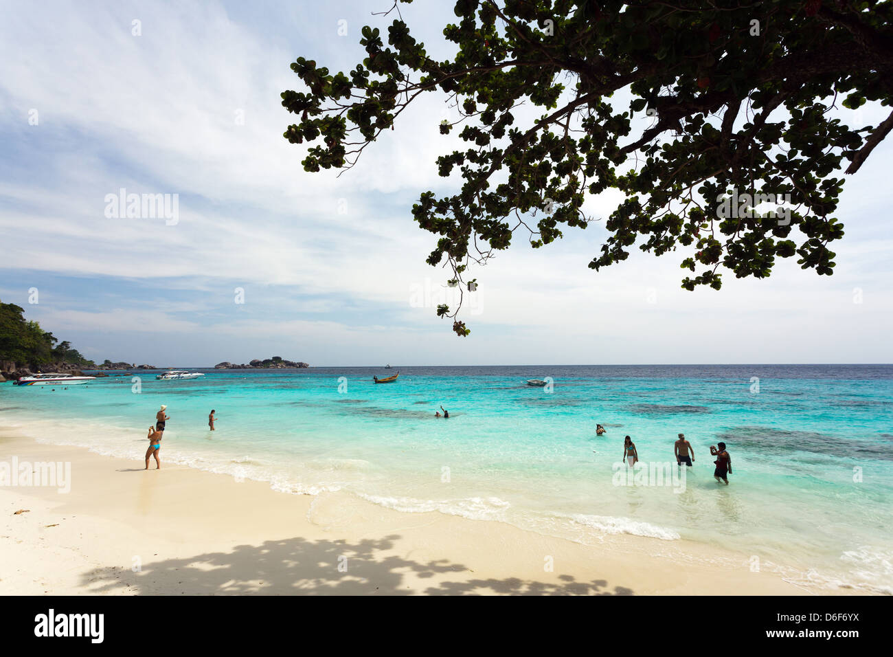 Russians tourists bathing on the Mu Ko Similan island beach, Thailand - Stock Image