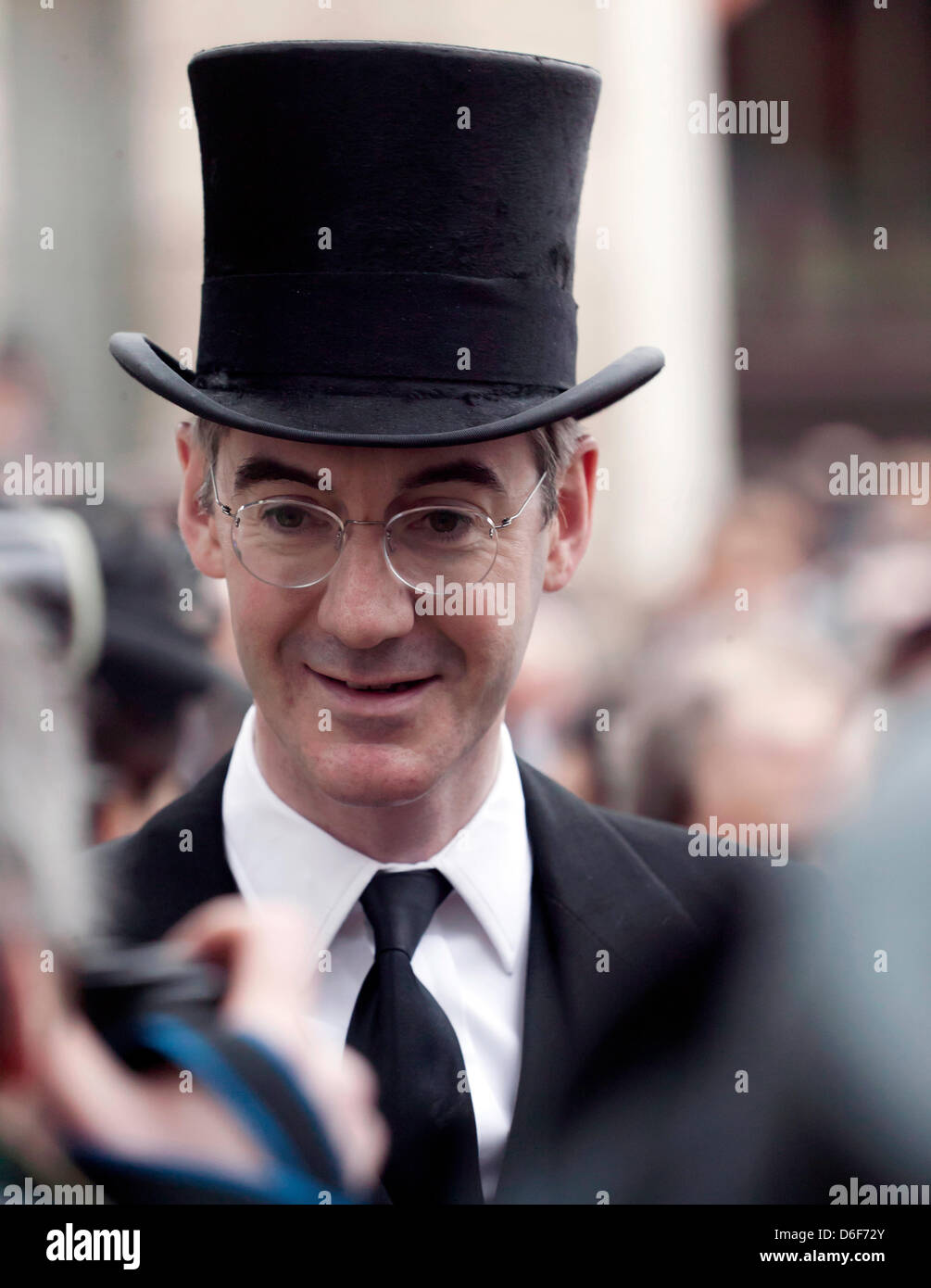 Jacob Rees-Mogg, wearing a top hat, waits to enter St Paul's Cathedral for Baroness Thatcher funeral - Stock Image