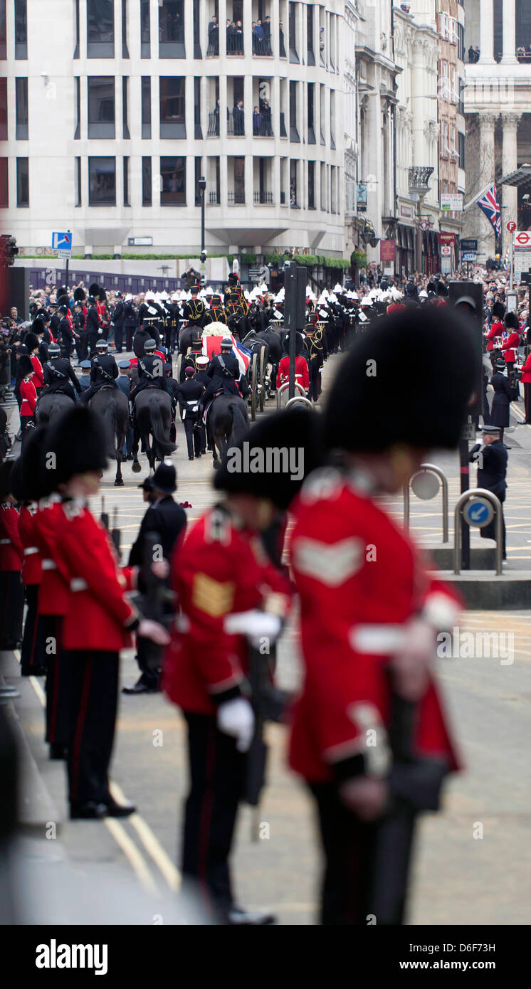 Welsh Guardsmen bow their heads as a mark of respect, as Baroness Thatcher funeral cortège  passed up Fleet - Stock Image