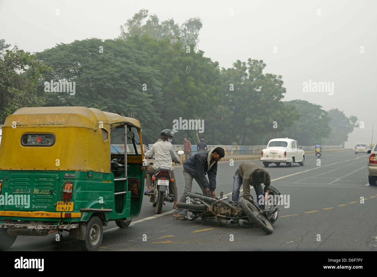 A tut-tu and motorcycle accident in New Delhi, India - Stock Image