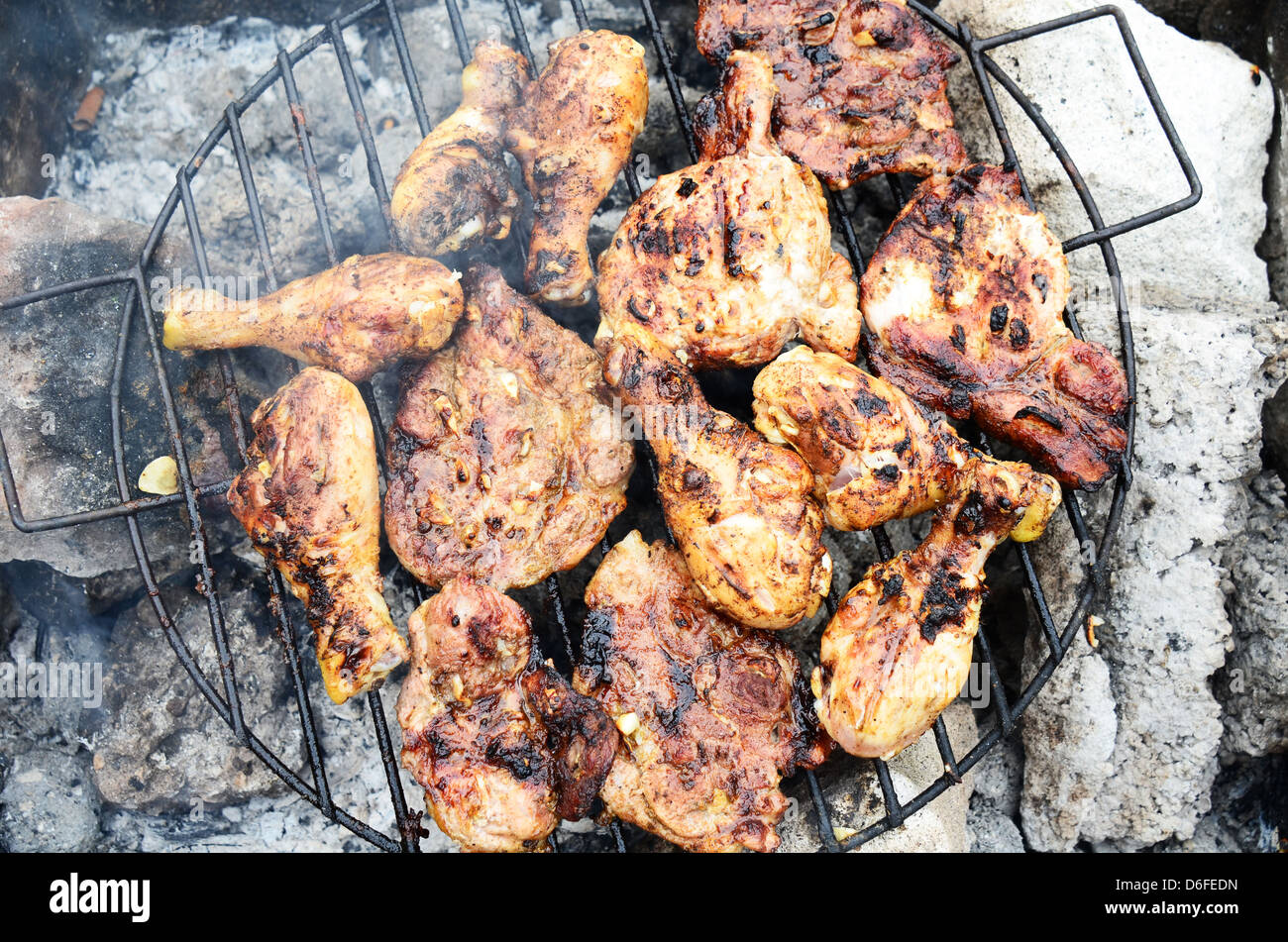 Chicken barbecue on outdoor camping - Stock Image
