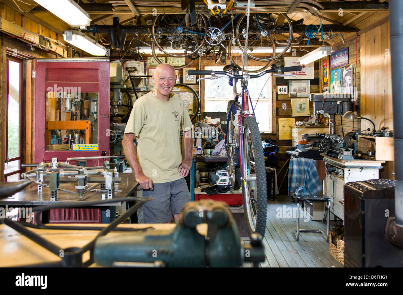 Custom bicycle frame craftsman Don MacClung photographed in his workshop along the Arkansas River in Salida, Colorado, - Stock Image
