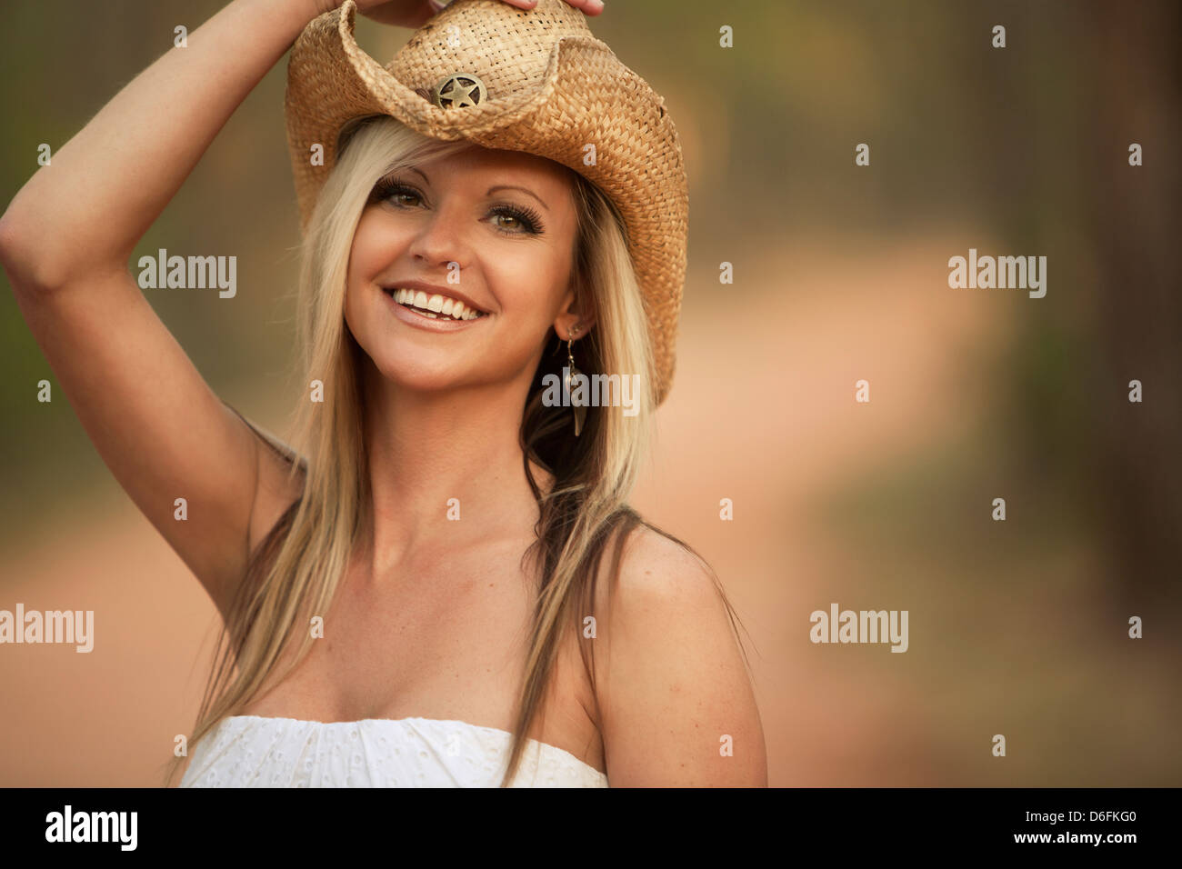 Portrait southern girl in cowboy hat outside - Stock Image