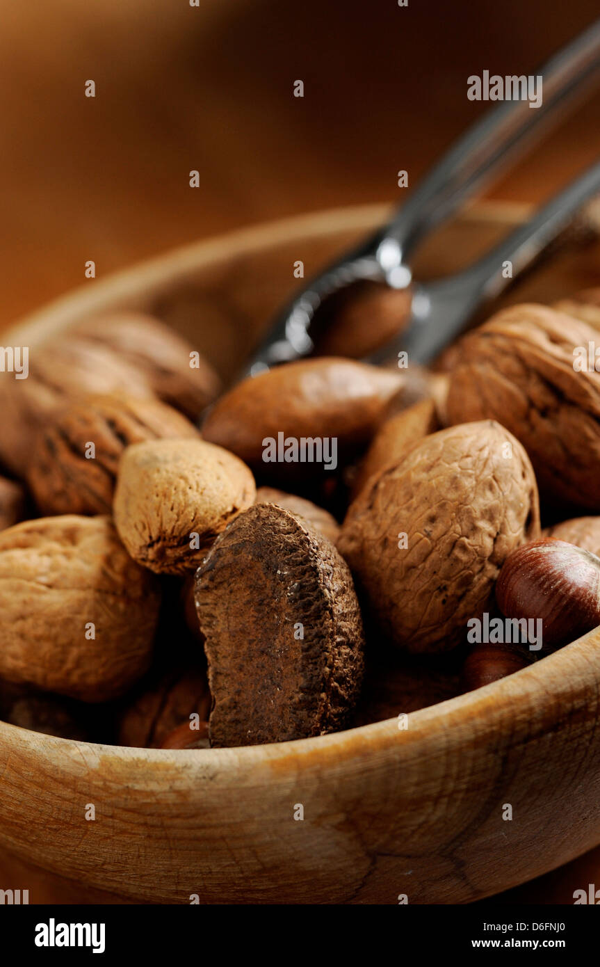Mixed nuts in bowl - Stock Image