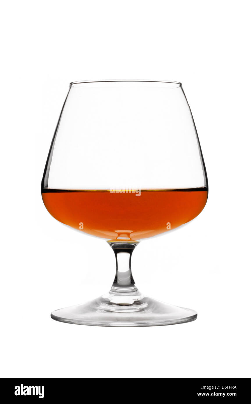 Glass of brandy on white background Stock Photo