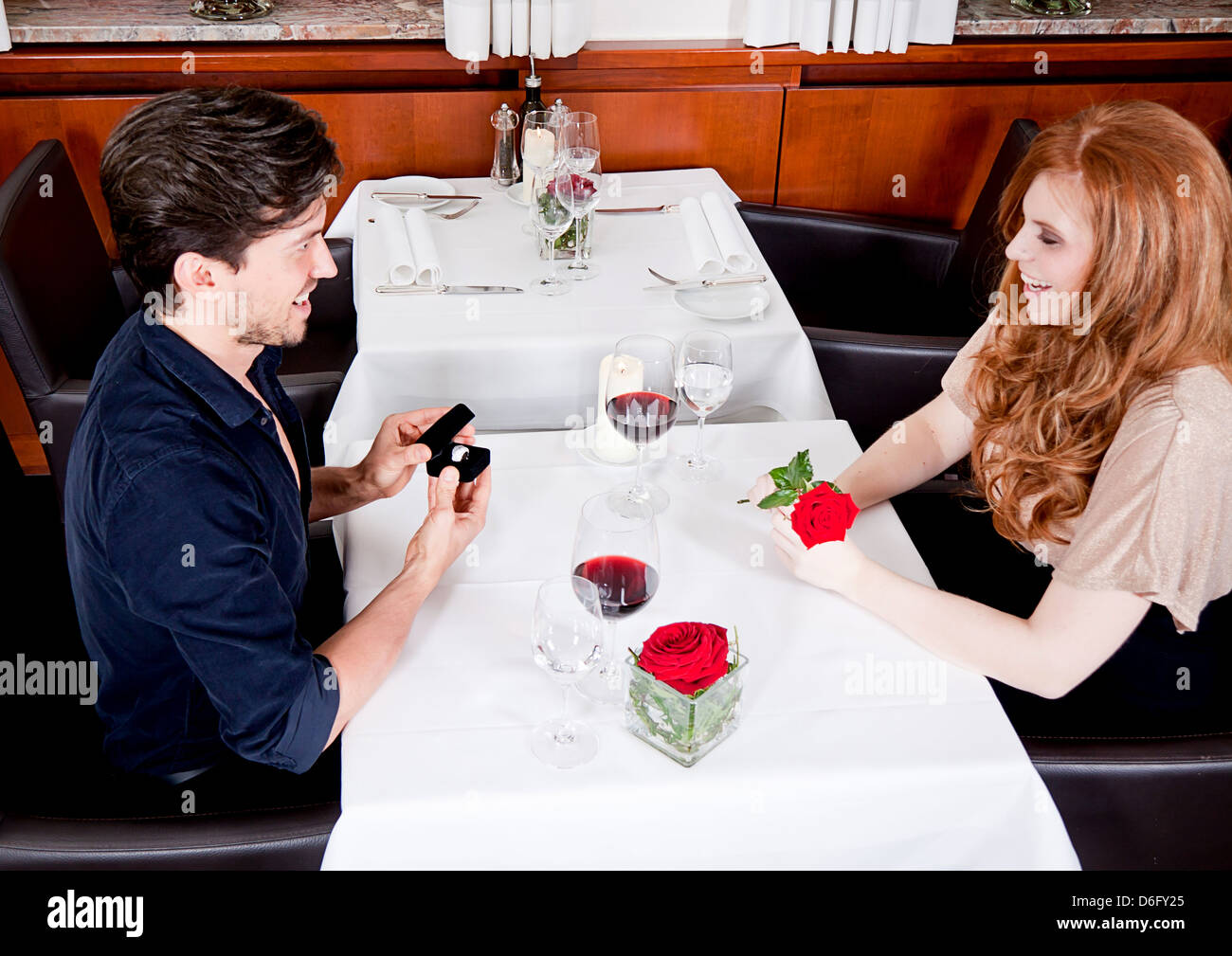 happy couple in restaurant romantic date love dinner valentines day wedding - Stock Image
