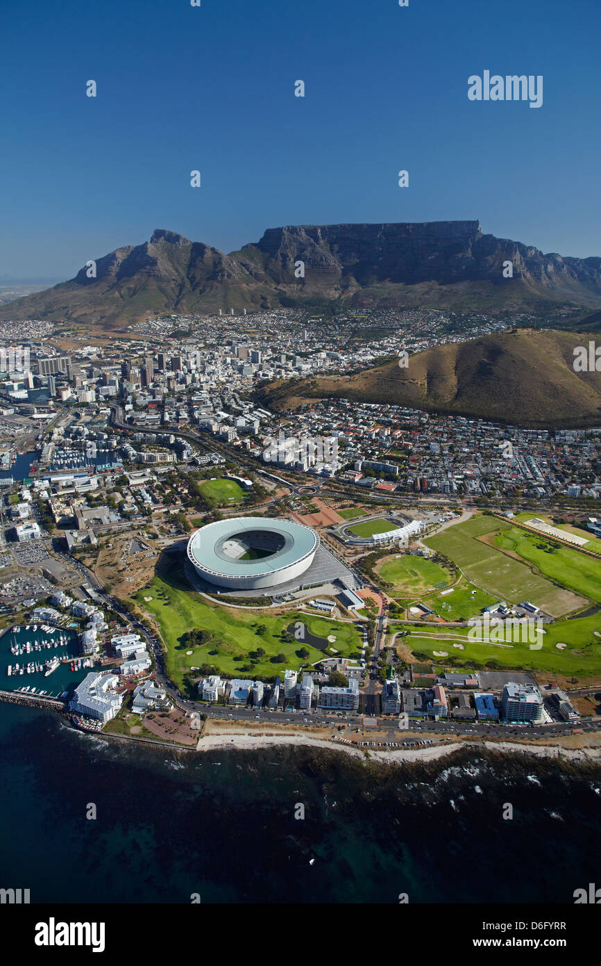 Cape Town Stadium, Metropolitan Golf Club, and Table Mountain, Cape Town, South Africa - aerial - Stock Image