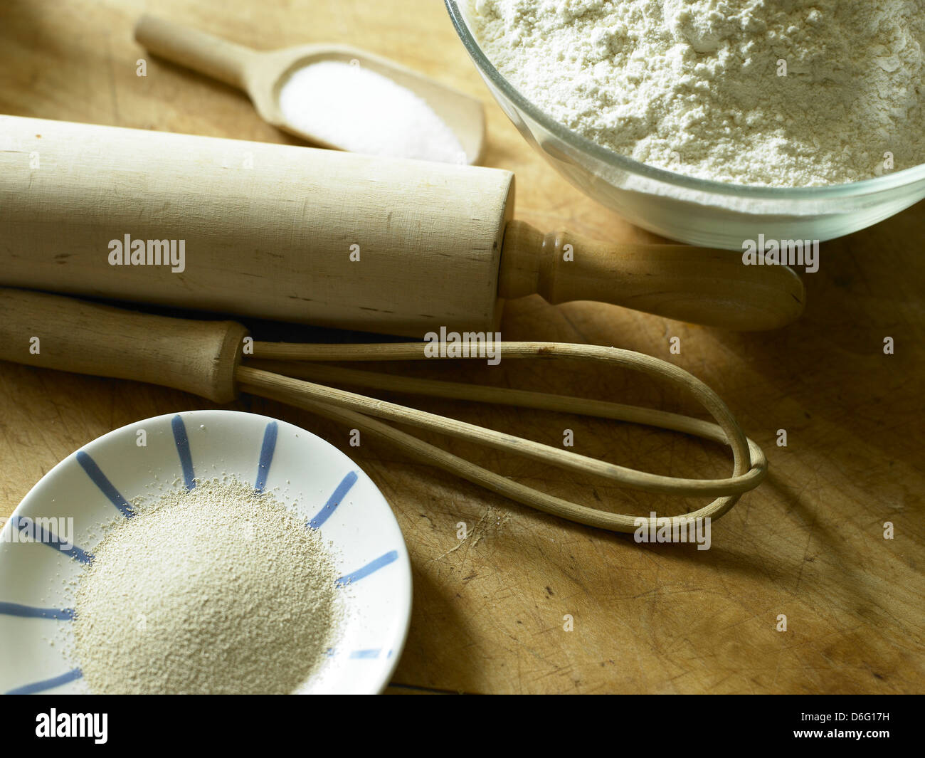 Flour, yeast, salt and baking props - Stock Image