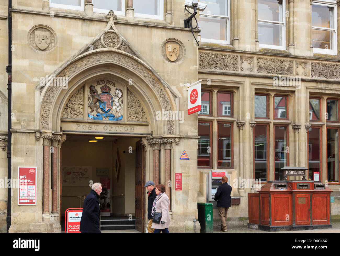 Old postboxes outside 19th century Victorian main Post Office building 1879 with crest and VR above the door. Oxford - Stock Image