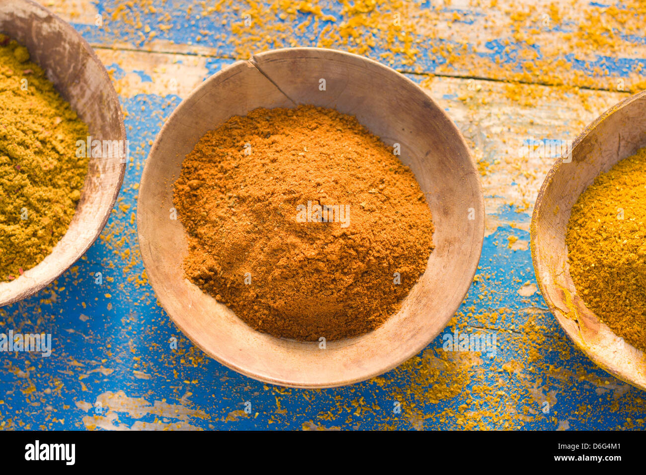 Curry powders, overhead view - Stock Image