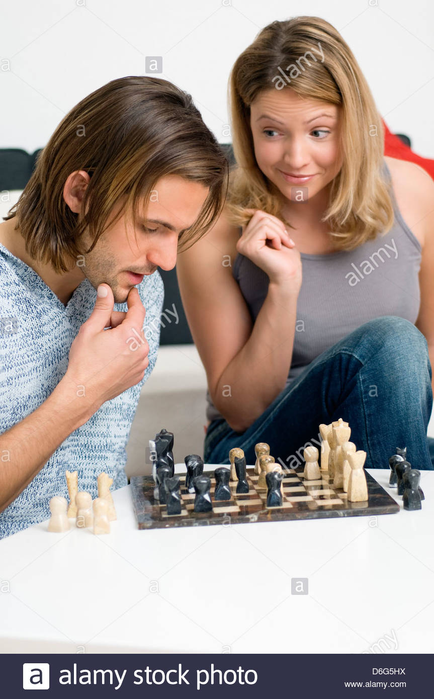 Young couple playing chess - Stock Image