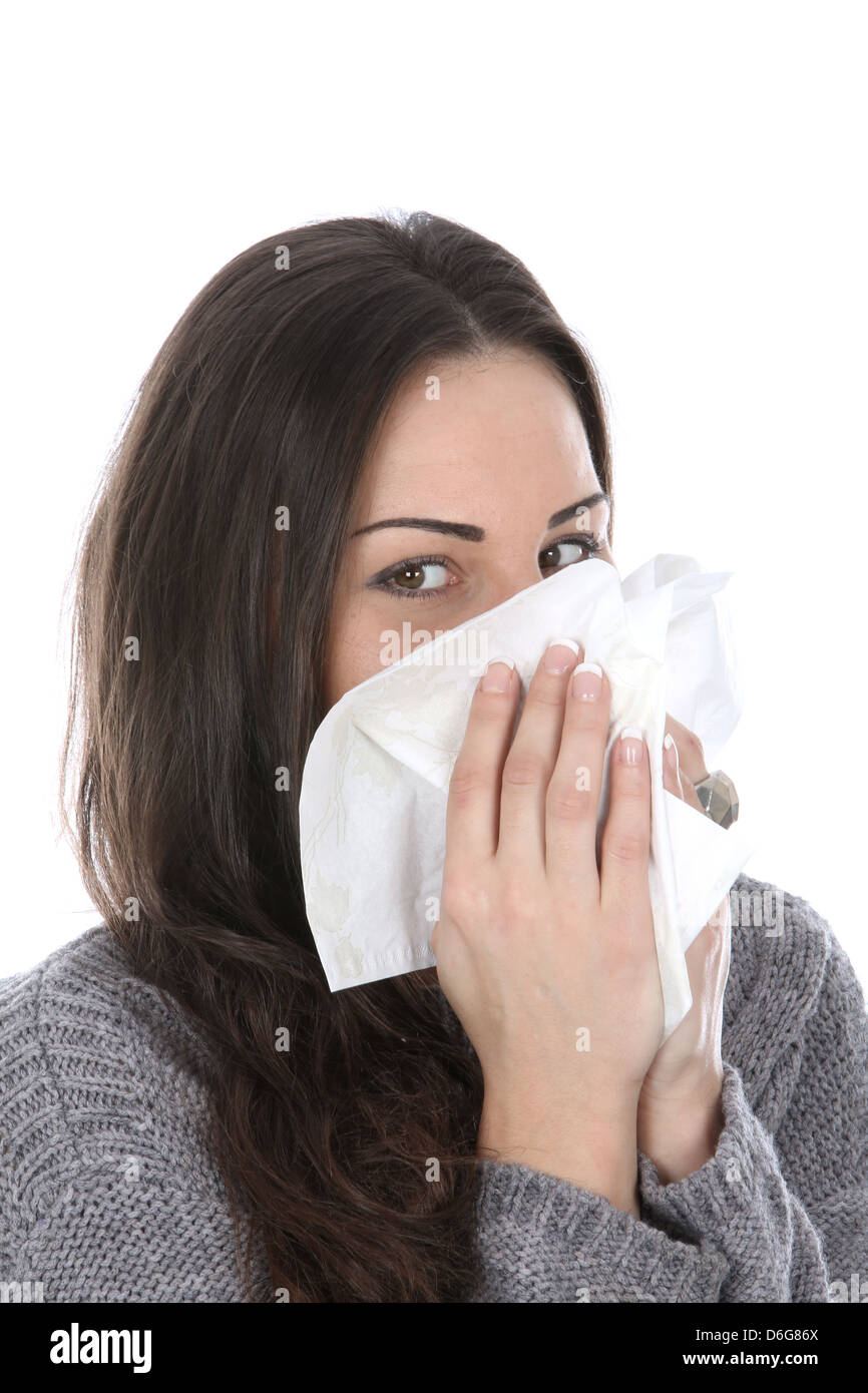 Woman Blowing Nose - Stock Image