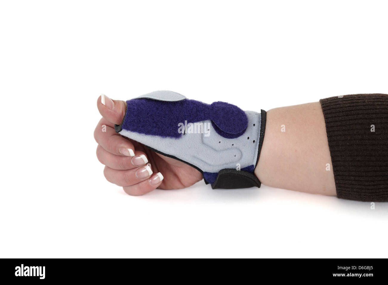 Wrist bandage shown on a woman's hand. Wrist orthosis for treating a carpal tunnel Syndrome, isolated on white. - Stock Image
