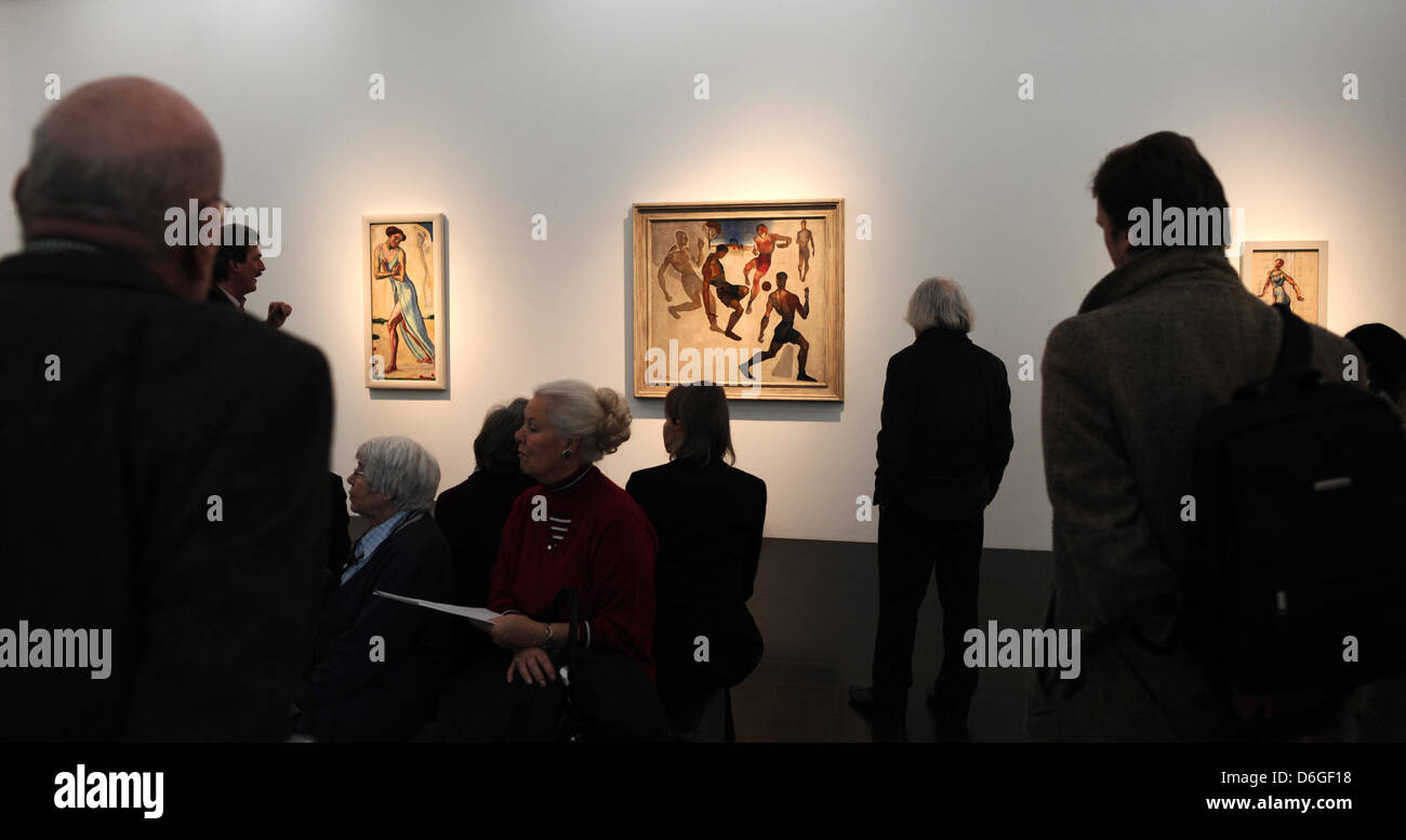Visitors look at the painting 'Fussballspieler' ('Soccer Player') by Aleksandr Deyneka during a - Stock Image