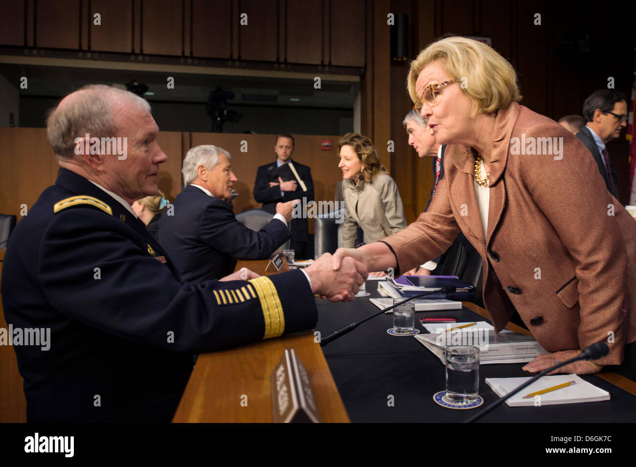 Chairman of the Joint Chiefs of Staff Gen. Martin Dempsey greets Senator Claire McCaskill before the start of the - Stock Image