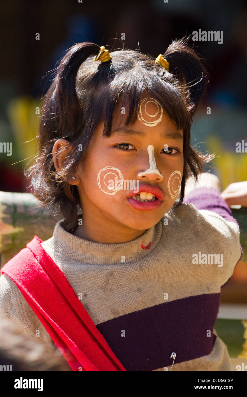 Cheeky little girl with Thanaka face decorations in Inn Thein Village, Myanmar 2 Stock Photo