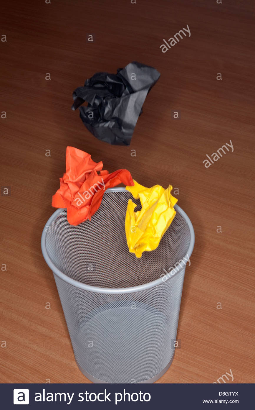 Paper falling into wastepaper Basket Munich Bavaria Germany - Stock Image