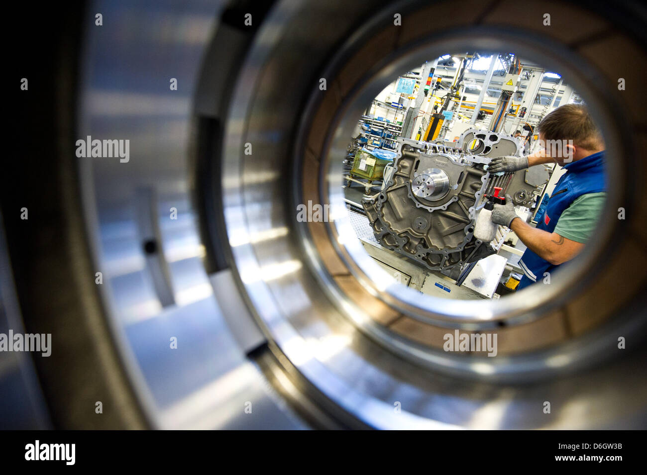An employee cleans the metal surfaces an engine type 4000 with a cloth at the MTUfactory in Friedrichshafen,Germany, - Stock Image