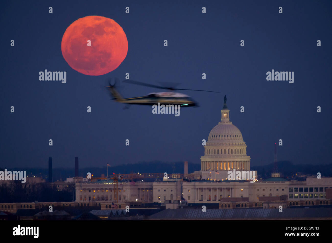 HANDOUT - A NASA handout picture dated 07 February 2012 shows the full moon and the U.S. Capitol early in the evening - Stock Image